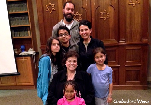 Marcy Goldberg in a family photo with her daughter, Rachel, center right, her son-in-law Jonathan Polin and grandchildren Hersh, 14; Leebie, 12; and Orly, 9. In front is 6-year-old Sha'La, who lives with Goldberg.
