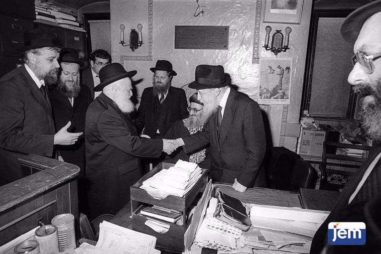 With Rabbi Avraham Shapira, who had come to visit the Rebbe together with his Sepharadic counterpart, Rabbi Mordechai Eliyahu, on 30 Cheshvan, 5744.