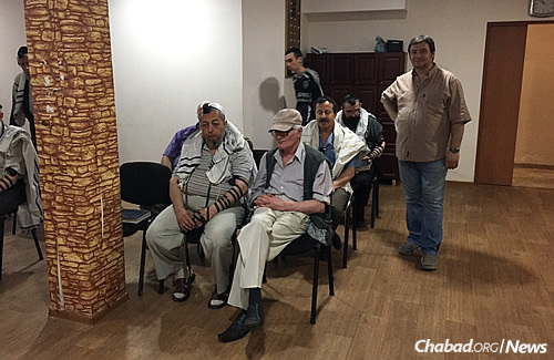 """Congregants in the synagogue. Gopin says """"people were also happy to see me because if I was able to return, even if just for a short visit, it already means things are getting a little better."""""""