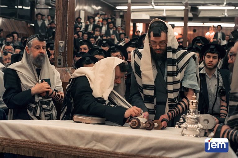 Standing to the Rebbe's right, as the Rebbe kisses the Torah on 6 Tishrei, 5747.