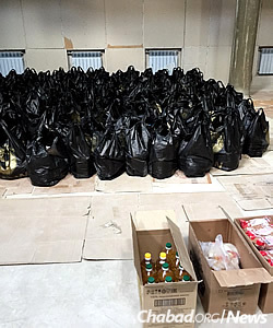 Nearly 700 food packages sponsored by the International Fellowship of Christians and Jews sit in the synagogue, waiting to be delivered to home-bound Jews in Lugansk. The aid contains nonperishable kosher items like oil and pasta.