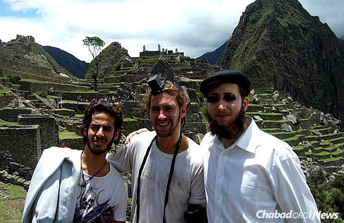 Putting on tefillin at Machu Picchu in Peru. (Photo: Mordechai Lightstone)