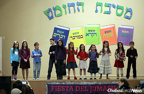 Students celebrate Torah study at Chabad's Wolfsohn-Tabacinic School in the Belgrano neighborhood of Buenos Aires. While the school's general education has remained first-class, the Jewish studies have, by all accounts, greatly improved in recent decades.