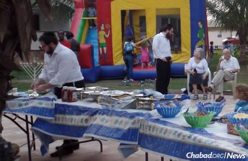 Before bringing his family, Majeski and rabbinical students hosted a Chanukah party in Accra, meeting many community members.