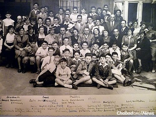 Winthrop's elementary-school graduation at Itzhak Katznelson Academy in Lodz, June 1939. The tallest, he is standing in the back row on the upper left. Winthrop said he recovered the photo from a boy standing second to his left, M. Syrkis, whose family managed to escape Hitler and travel to what was then British Mandate Palestine. Winthrop got the photo from his schoolmate while on a visit to Israel in 1964, when he was working for Bank Leumi.