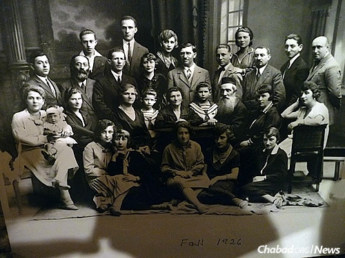 Winthrop's extended family in a photo dated in the fall of 1926. His mother is at the far right, seated in the chair, pregnant with Winthrop. His father is standing behind her. The two boys in the center are brothers and his second cousins, and the only other survivors from the entire photograph; they escaped to the Soviet Union.