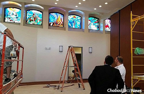 Some of the stained-glass windows in place before construction was complete.