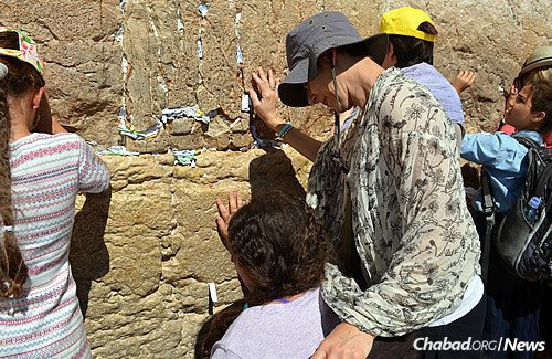 Also at the Western Wall are Debby Suris and her daughter, Carlie, who is in a wheelchair.