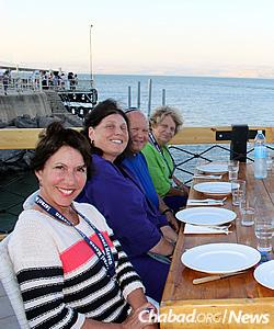 Dinner by the sea: Julie Burnett, Devorah and Marty Newman, and Devorah's mother, Annette Newman