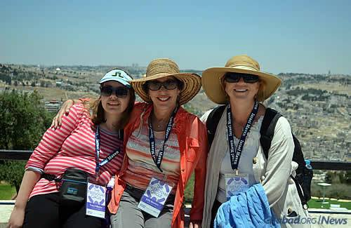 Tracy Nikolas, Julie Burnett and Kelly Sherwood at the Haas Promenade, with a view of Jerusalem in the background