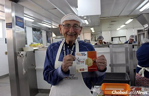 Marvin Berman helps out at Colel Chabad's Pantry Packers warehouse in Jerusalem.