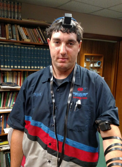 Nick in tefillin for the first time in his life.