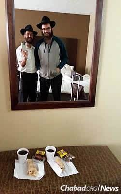 A selfie in one of the many hotel rooms they stayed along the way, with their makeshift kosher breakfast.