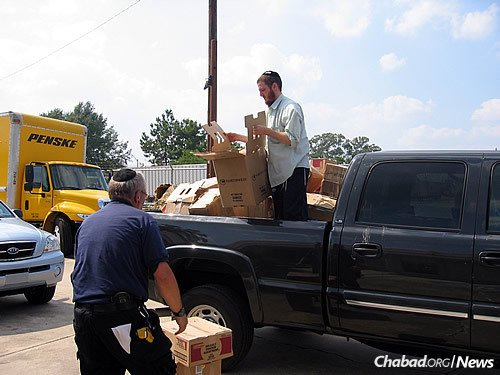 Packing a truck with supplies they will deliver to people and to local shelters.