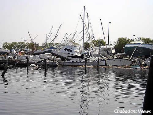 Damaged boats pulled in by the strength of the water, some all the way onto land.