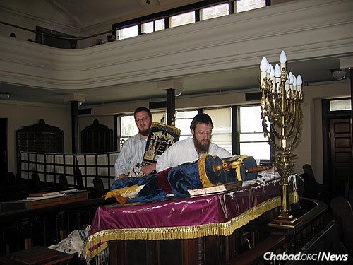 Taking Torahs to safety from a local synagogue.