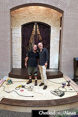 Rabbi Yossel Kranz, right, co-director of the Chabad center. Unable to find a bimah for their needs, they designed and built their own.