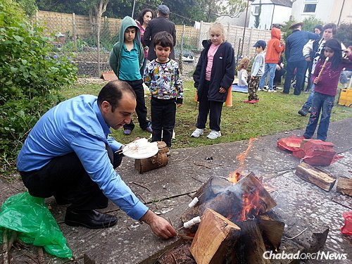 Roasting marshmallows at a Lag BaOmer bonfire this spring. There are signs of growth in Cardiff: A handful of families have moved to town, mostly Israelis, as well as a few younger single people.