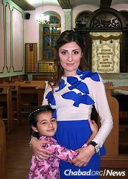 A woman and her daughter at the synagogue in Donetsk. While most of the Jewish community still there are elderly, families do remain.
