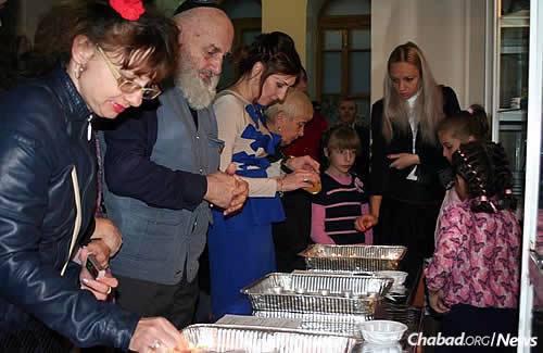 Women and girls light candles before the start of Rosh Hashanah.