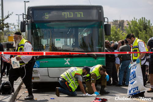 Rescue personnel respond to the scene of a stabbing attack at the light-rail station in Jerusalem on Oct. 8. A terrorist stabbed and wounded two Israelis, the fourth incident in Jerusalem over the course of the week. (Photo: Yonatan Sindel/Flash90)