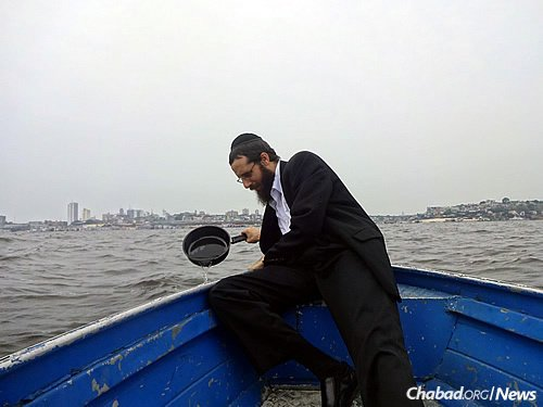 The rabbi periodically takes a boat out to the river to immerse new food vessels, as mandated by Jewish law. A mikvah would make the process much easier.