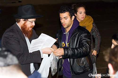 """Charity was also collected by the students that night. Rabbi Boyarsky, left, said he """"was amazed at how well they spoke—really amazed. They spoke from their hearts."""" (Photo: Erik Plumadore)"""