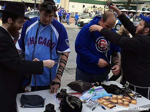 The booth has been attractive to Jewish baseball fans, some even linking the Cubs strong season with the rabbis' presence.