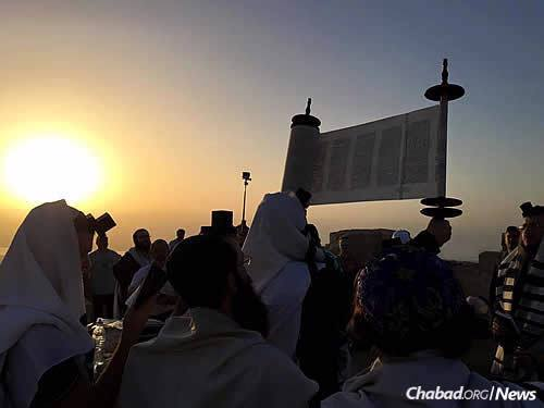 A delegation of 50 rabbis and Russian Jewish community leaders spent four days on a solidarity mission to Israel as terror attacks have gripped the nation. Here, they hold morning minyan atop Masada—a Jewish symbol of resistance and courage—one of a number of stops on their visit.
