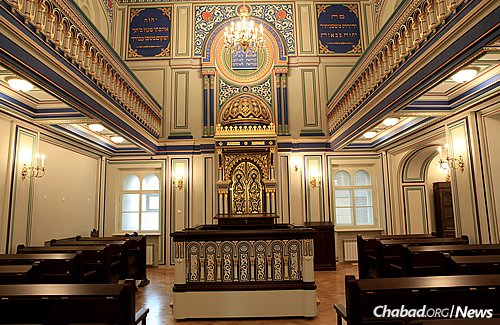 """The """"Small Synagogue"""" of St. Petersburg's gold-covered bimah, uniquely patterned ceiling and wooden floors exemplify the architectural glory of the synagogue."""