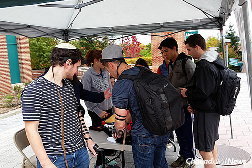 Men took the opportunity to put on tefillin during the four hours that the mitzvah booth operated on campus. (Photo: Chabad of Binghamton)