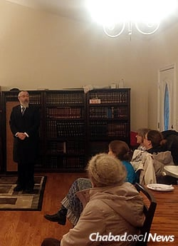 Rabbi Yosef Greenberg, director of the Lubavitch Jewish Center of Alaska, speaks at the Sukkot program run by his son.