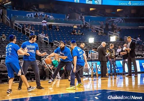 Adults joined in as well, dribbling down the court and shooting some hoops at Sunday's Magic game in Orlando, Fla. (Photo: Michael Fried, www.sonacityphotography.com)