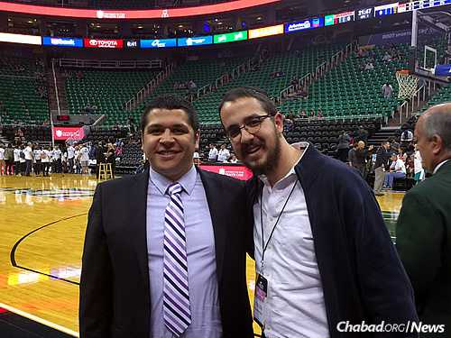 Rabbi Avremi Zippel, right, program director of Chabad Lubavitch of Utah in Salt Lake City, is organizing what he hopes will be the largest crowd yet for a menorah-lighting in Utah's history before a basketball game on Wednesday, Dec. 9, between the Jazz and the Knicks. Here, he is courtside with one of the Jazz team's representatives, Myles Melendez.