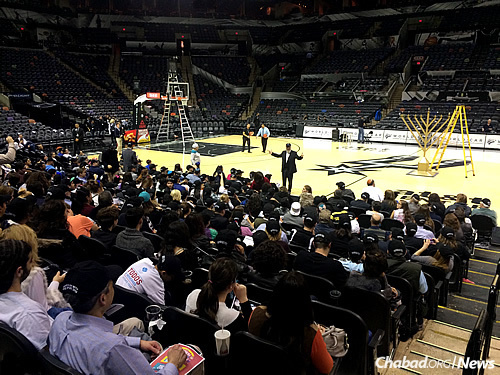 Chanukah with the Spurs will be celebrated on Monday, Dec. 14, when the team plays the Utah Jazz, with the menorah-lighting before the game (Rabbi Chaim Block, executive director of the Chabad Center for Jewish Life & Learning in San Antonio, speaks to the crowd at last year's game). It's one of at least 17 Chabad centers planning holiday events at NBA and NHL games this season.