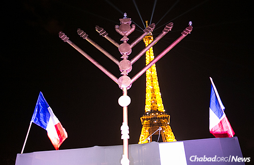 The Chanukah menorah at the base of the iconic Eiffel Tower. (Photo: Thierry Guez)