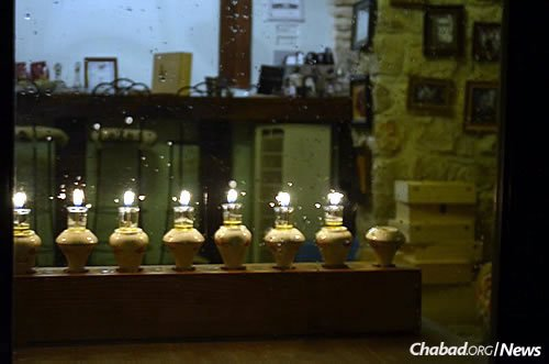 A menorah in a window in the northern Israeli city of Safed. A Chanukah tour, led by guides organized by Ascent of Safed, works it way along the streets and lanes there, focusing on the vast array of lights for the holiday. (Photo: Ascent of Safed)