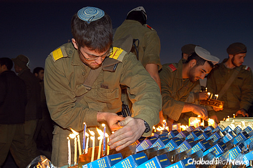 Soldiers light menorahs on their military bases. (Photo: Chabad of Eilat)