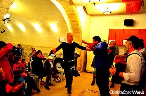 """""""You are bound to hear the klezmer music calling out to you—calling for you to join in the dance, just as the flames of the Chanukah lights dance upon their wicks."""" (Photo: Ascent of Safed)"""