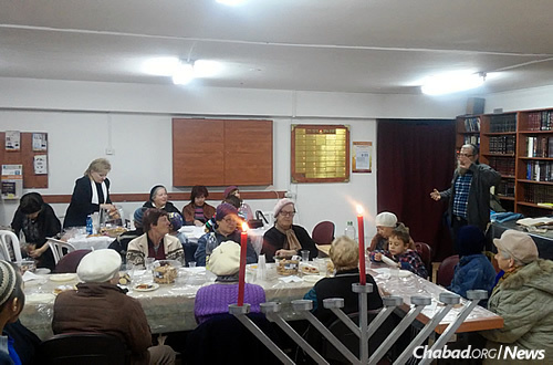 A program for Russian speakers, where Rabbi Aharon and Basya Moshkevich, co-directors of Chabad of Ariel, speak about Chanukah, its meaning and its relevance today. (Photo: Chabad of Ariel)