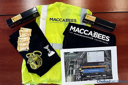 """A variety of gear from the Michigan-based Company Folders, Inc., was provided to event volunteers, called """"MaccaDees,"""" who worked behind the scenes to make the downtown event run smoothly."""