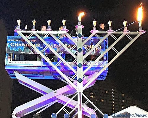 The lighting of the menorah by Steve Rosenthal, president of Rock Companies, a Quicken Loan company. Michigan Supreme Court Justice Richard Bernstein lit the shamash (utility candle).