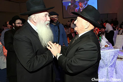 Rabbi Yitzchak Kogan greets Rabbi Berel Zaltsman, who was a member of the underground Chabad community in Samarkand, Soviet Asia, until his emigration in 1972. Zaltsman was a guest speaker at the Moscow 19 Kislev gathering.
