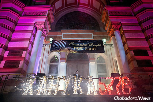 "Fireworks explode off of words spelling ""Chanukah 5776"" in Cyrillic script outside the Grand Choral Synagogue in St. Petersburg."