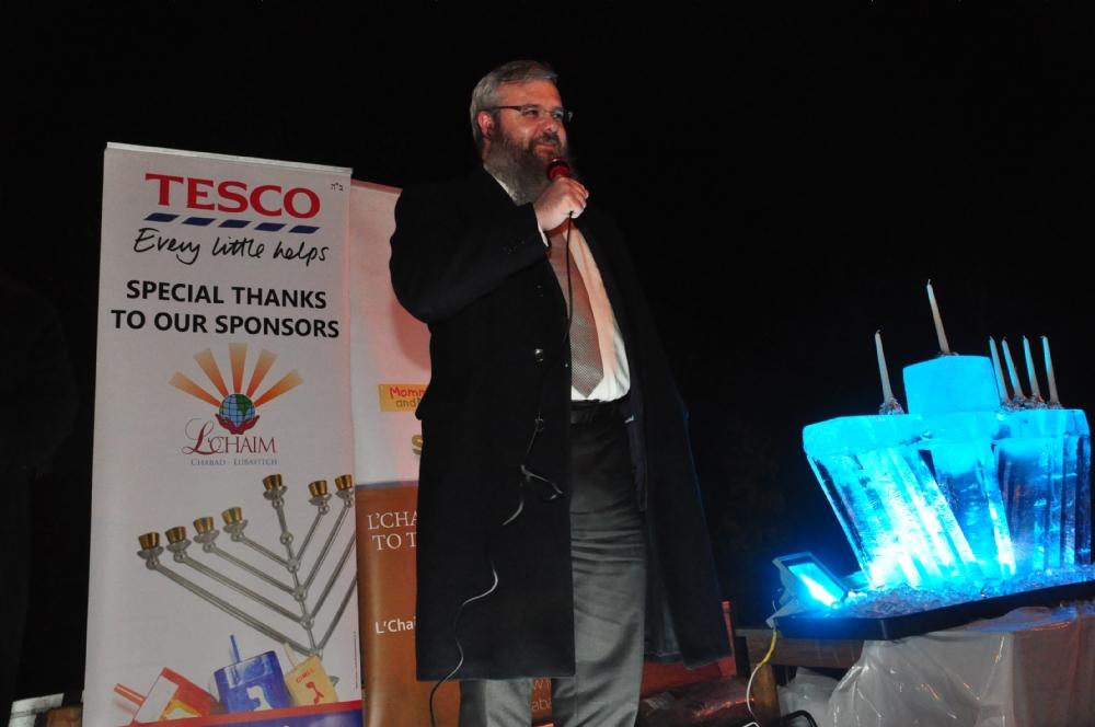 Rabbi Walker speaking at the Chanukah event.JPG