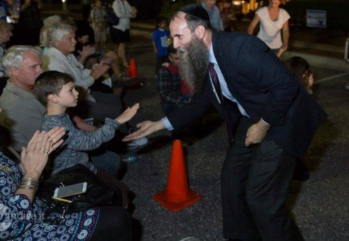 Judah enjoys a light moment with Chabad Rabbi Zvi Konikov.