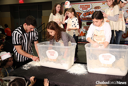 "Children take part in a challah-themed game show during the record-breaking ""Kids Mega Challah Bake"" in New York City. (Benams Photo)"