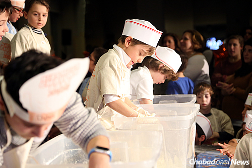 Kneading the dough; both boys and girls were involved. (Benams Photo)