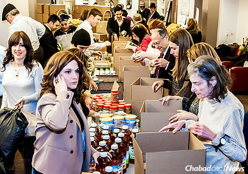 Volunteers packed boxes of kosher food for the hungry in New York City last week as part of the Chabad Relief Project, an affiliate of Chabad Lubavitch of Midtown Manhattan.
