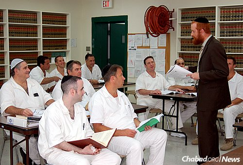 """Rabbi Dovid Goldstein—director of Chabad-Lubavitch of West Houston, associate director of Chabad Outreach in Houston and the lead Jewish chaplain in the Texas prison system—leads a """"shiur,"""" a lesson, in the Jewish-enhanced program at the Stringfellow Unit, a Texas Department of Criminal Justice prison in Rosharon, Brazoria County, Texas."""